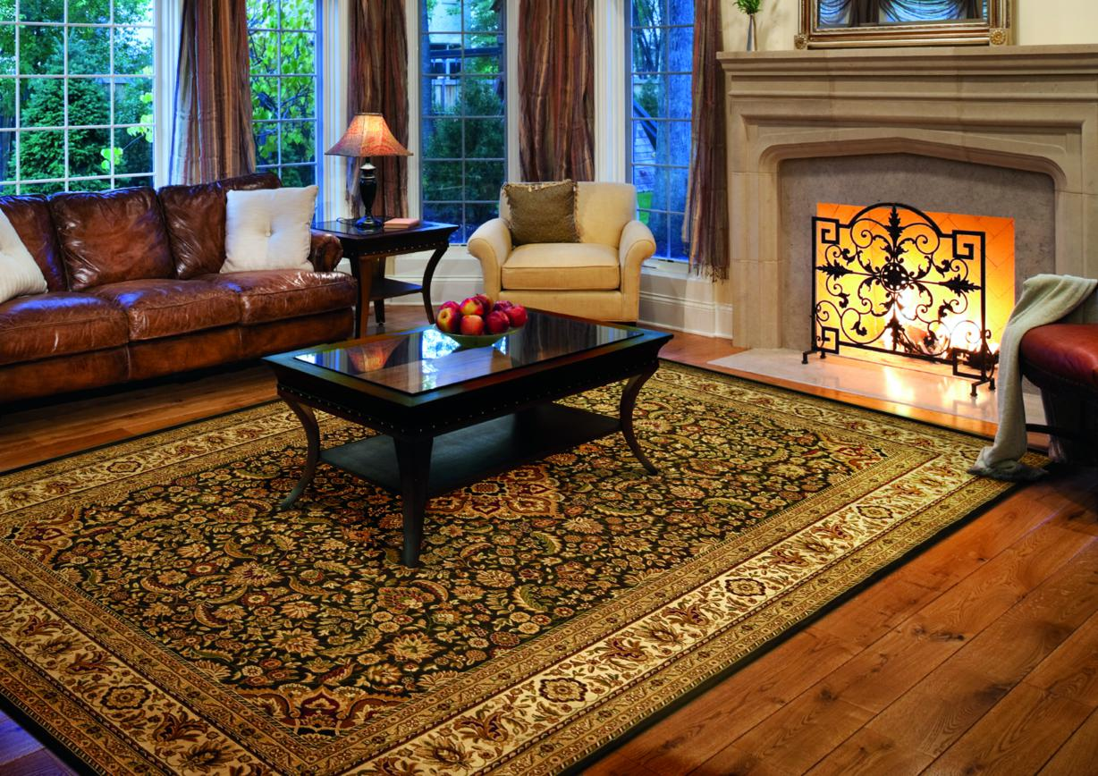 charming floral rug by orian rugs on wooden floor plus brown leather sofa plus fireplace for living room decor ideas
