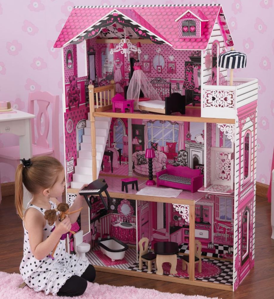charming kidkraft majestic mansion dollhouse 65252 made of wood in pink theme on wooden floor matched with pink wallpaper for kids room decor ideas