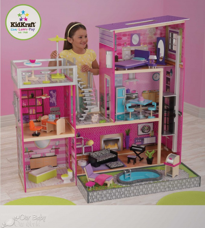 Charming Kidkraft Majestic Mansion Dollhouse 65252 Made Of Wood In Pink Theme On Wooden Floor Which Matched With Pink Wall For Kids Room Decor Ideas