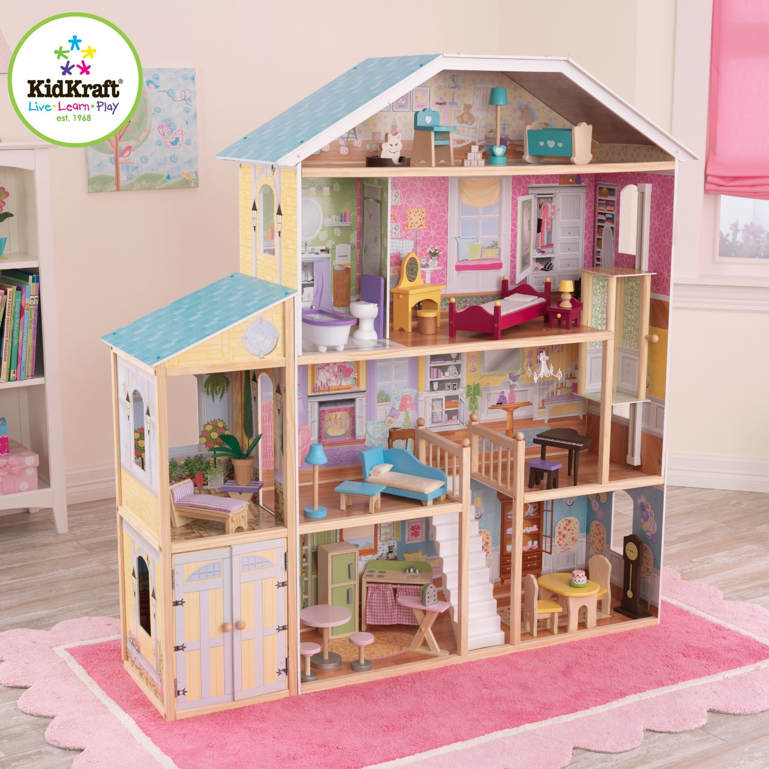 charming kidkraft majestic mansion dollhouse 65252 made of wood on pink rug matched with beige wall for kids room decor ideas