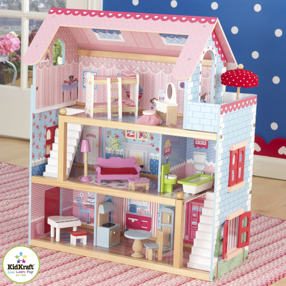 charming kidkraft majestic mansion dollhouse 65252 made of wood on pink stripped rug matched with blue wallpaper for kids room decor ideas