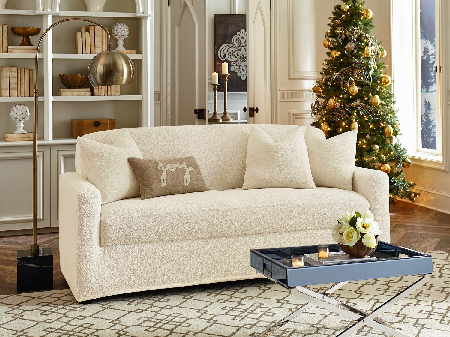 charming sofa with white surefit cover plus white rug on wooden floor for living room decor ideas