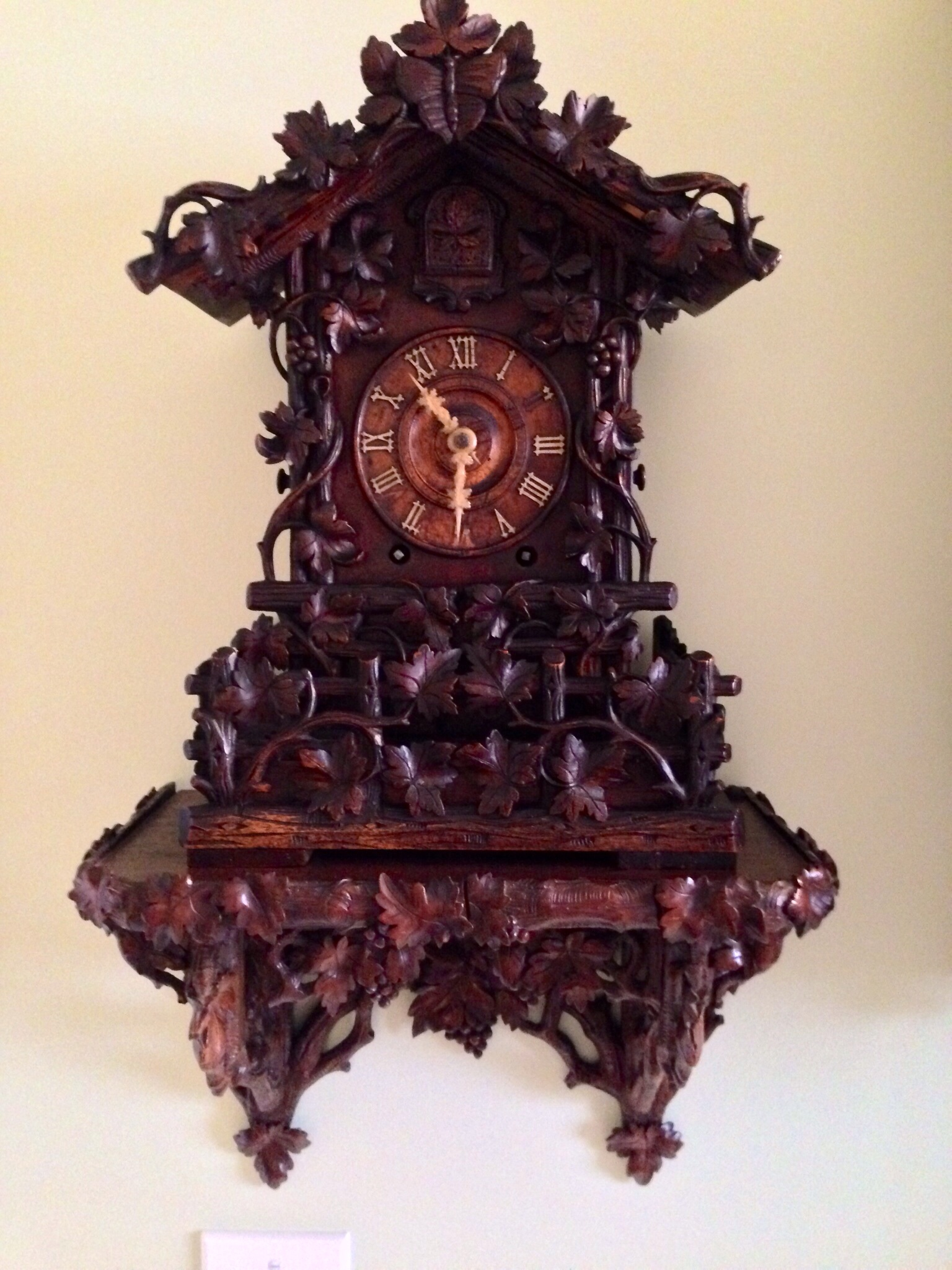 chic cuckoo clock in brown made of wood with wonderful carving for home furniture ideas