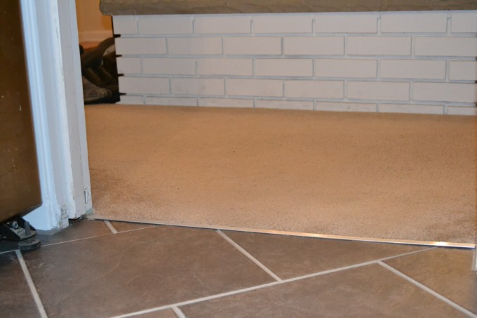 Chic Flooring With Schluter Strip Between Rug And Tile Floor For Flooring Ideas
