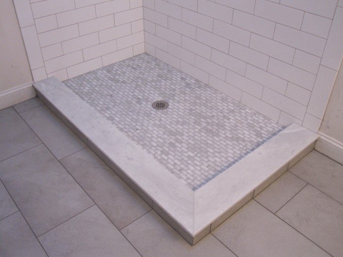 Chic Showes Stall With Tile Flooring And Schluter Strip On Tile Edgeing Matched With White Tile Wall For Bathroom Decor Ideas