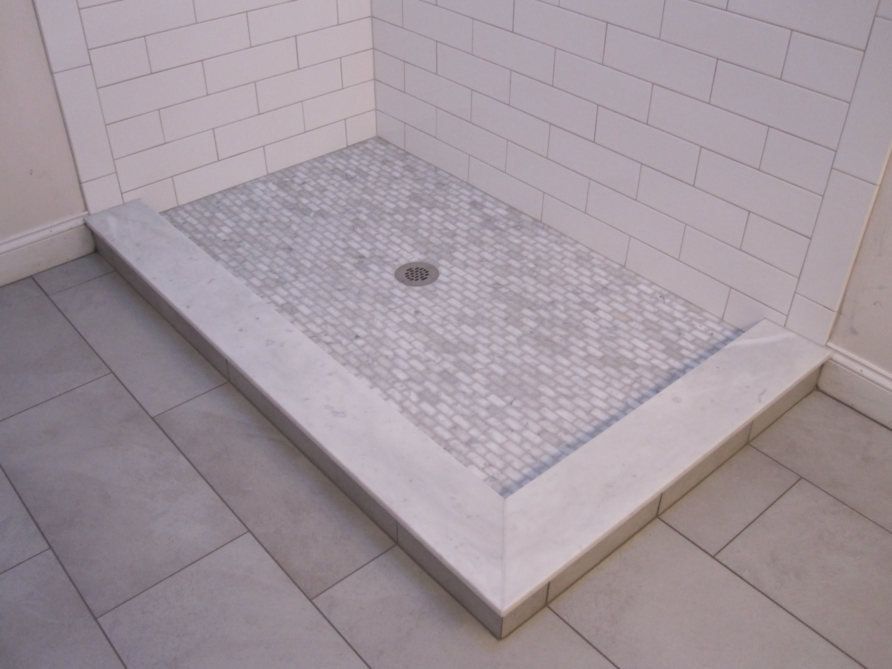 Decorating inspiring edging and trim using schluter strip ideas chic showes stall with tile flooring and schluter strip on tile edgeing matched with white tile doublecrazyfo Choice Image