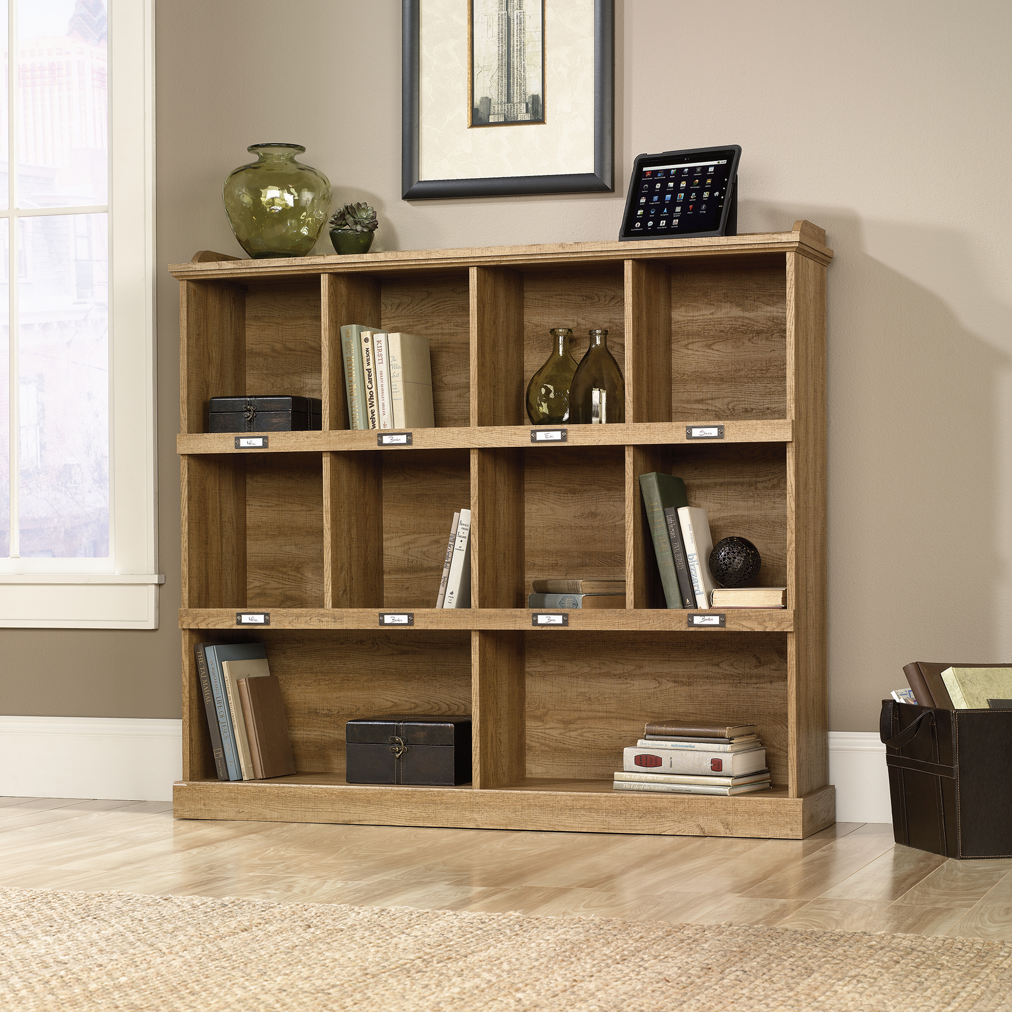 chic wooden bookcase by sauder furniture on wooden floor which matched with tan wall for living room decor ideas