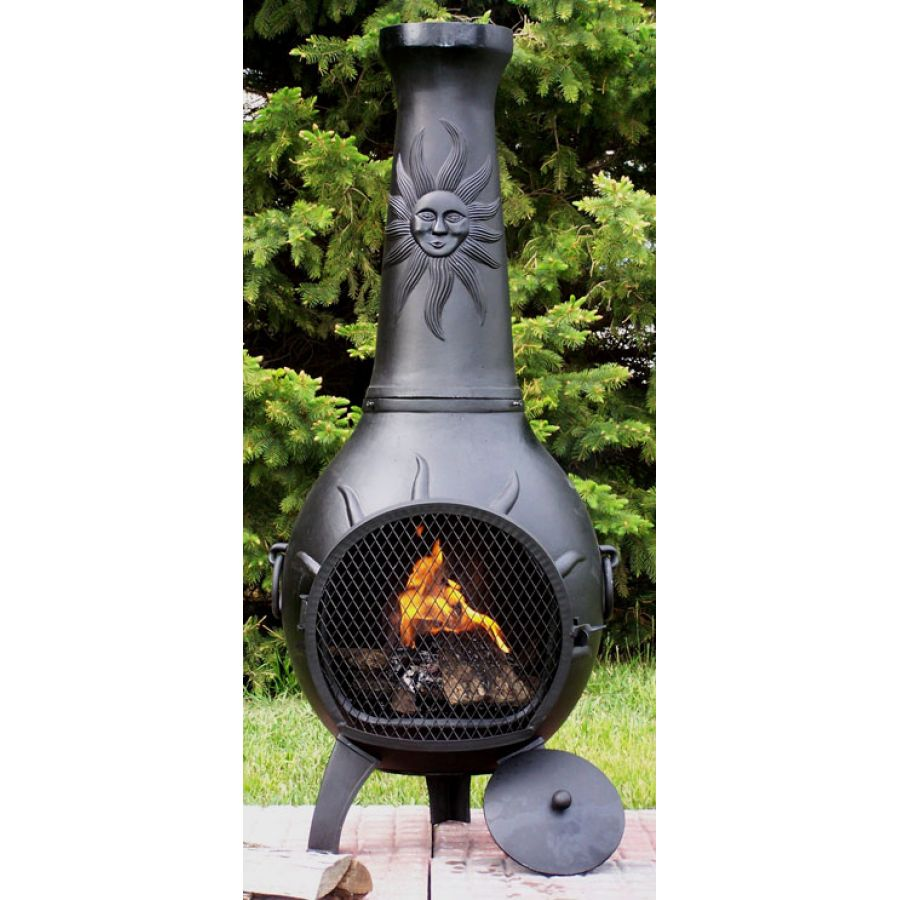 chiminea outdoor fireplace in black with sun ornament for patio furniture ideas