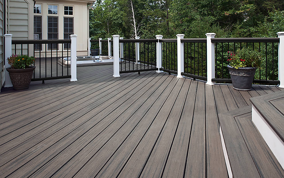 cozy decking IN ISLAND MIST with railing Charcoal Black with round aluminum balusters and Classic White posts for standard trex decking cost ideas
