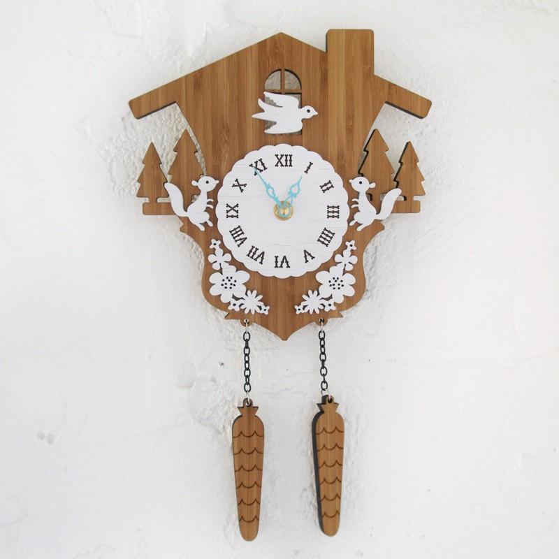 cute cuckoo clock in white and brown theme with bird and squirrels ornament for home accessories ideas