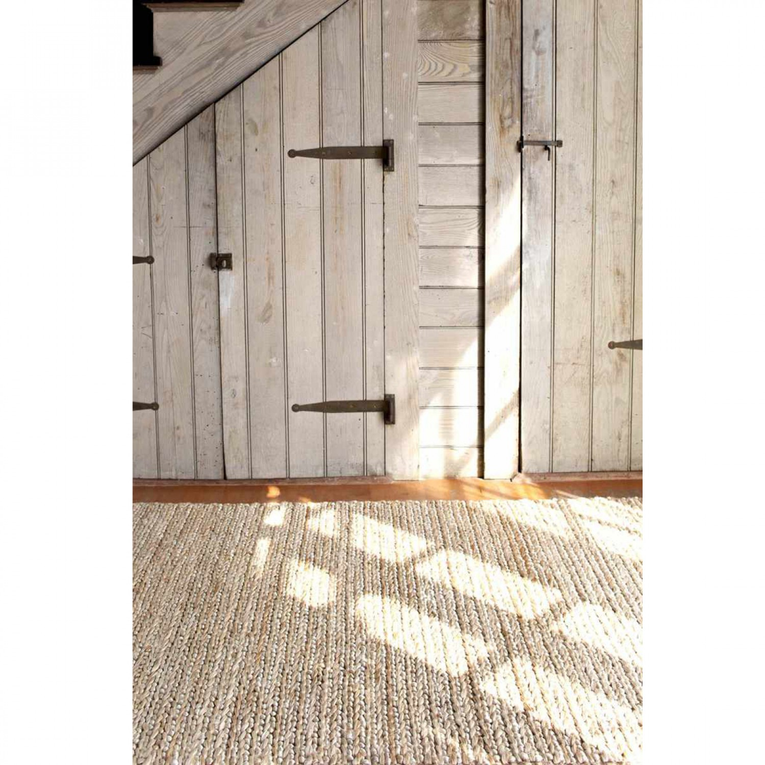 Dash And Albert Rugs natural jute woven on wooden floor which matched with white wall for interior design ideas