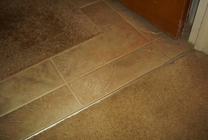Edging Between Rug And Tile Using Schluter Strip For Flooring Ideas