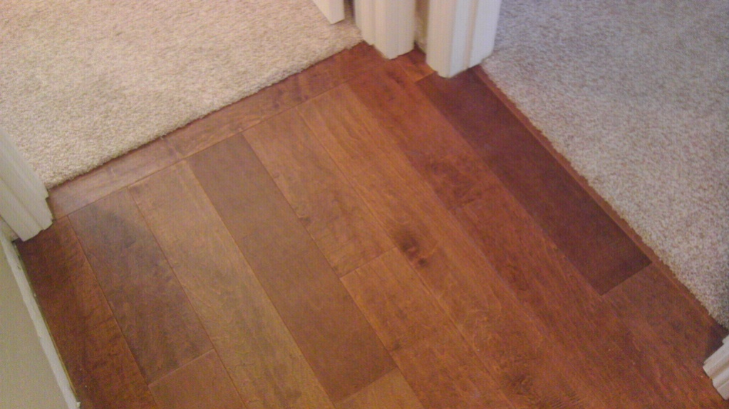 edging between rug and wooden floor using schluter strip for flooring ideas