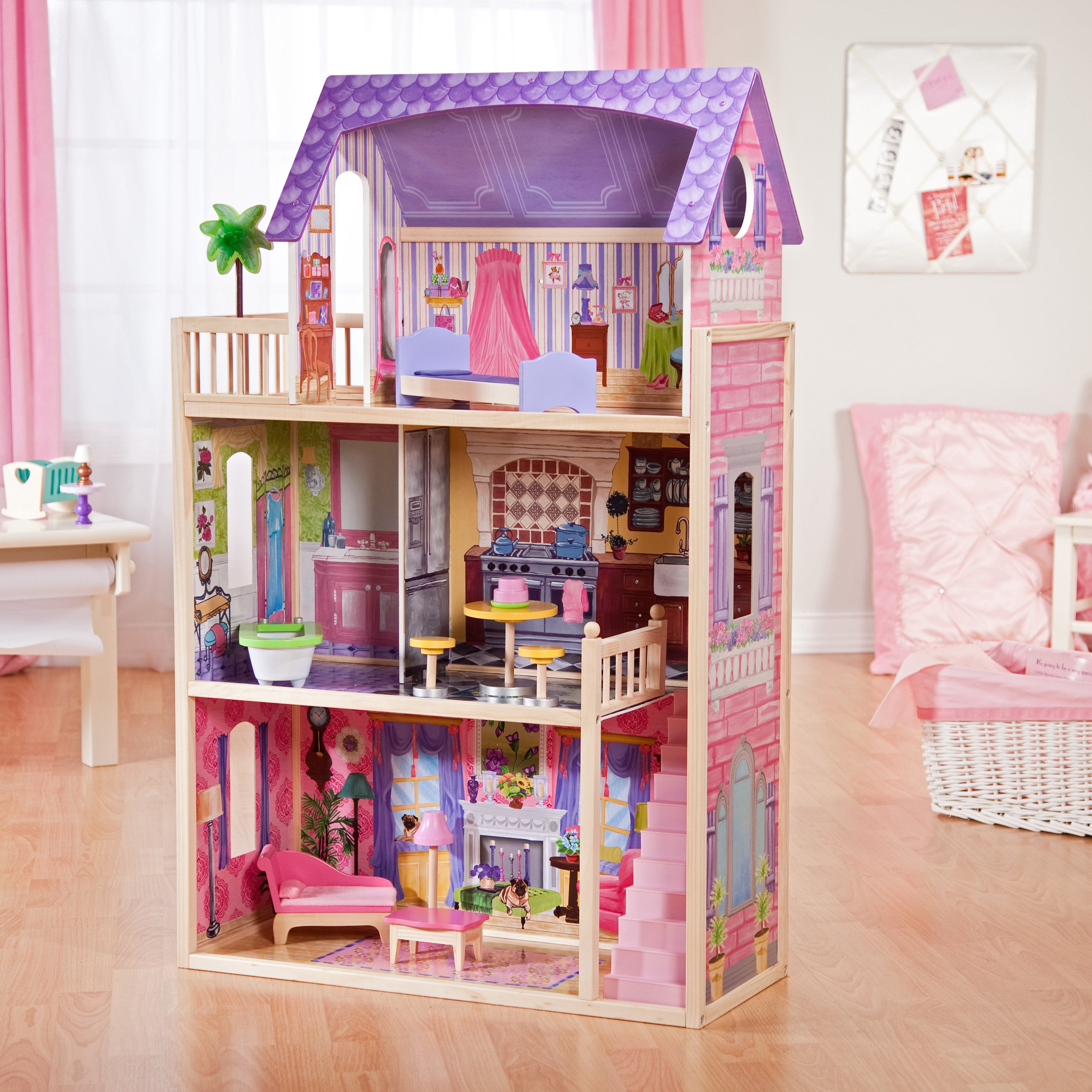 fantastic kidkraft dollhouse made of wood in pink and purple theme on wooden floor which matched with white wall with pink curtain for lovely nursery decor ideas
