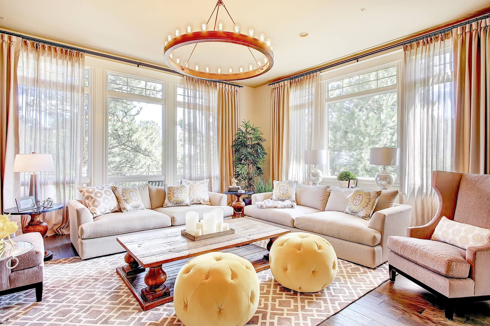 GORGEOUS loloi rugs on wooden floor plus cream sofa set under the sweet chandelier for living room decor ideas