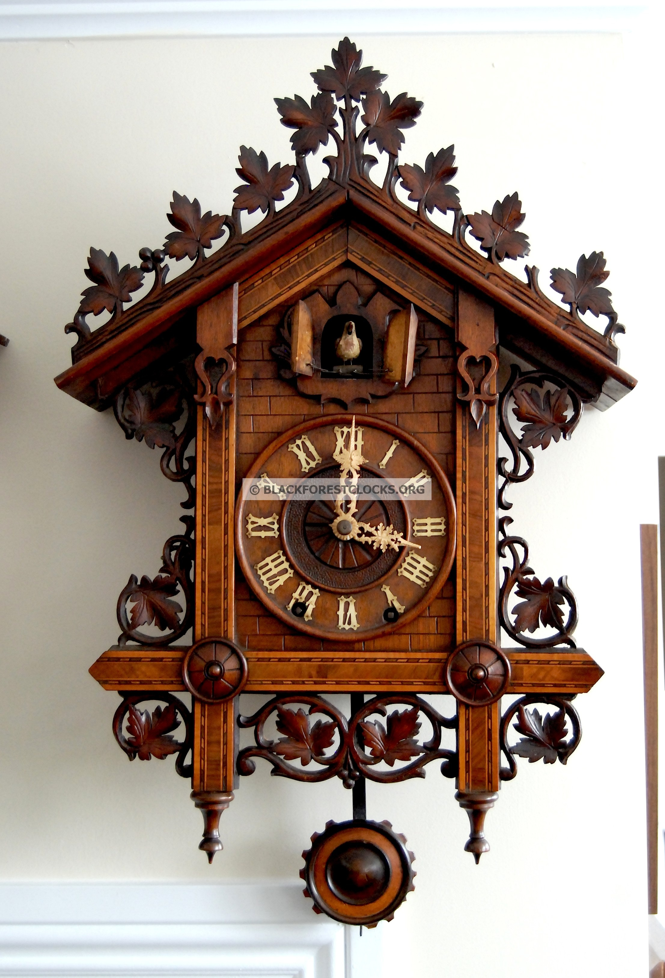 lovely cuckoo clock in brown made of wood with carving and home design for home accessories ideas