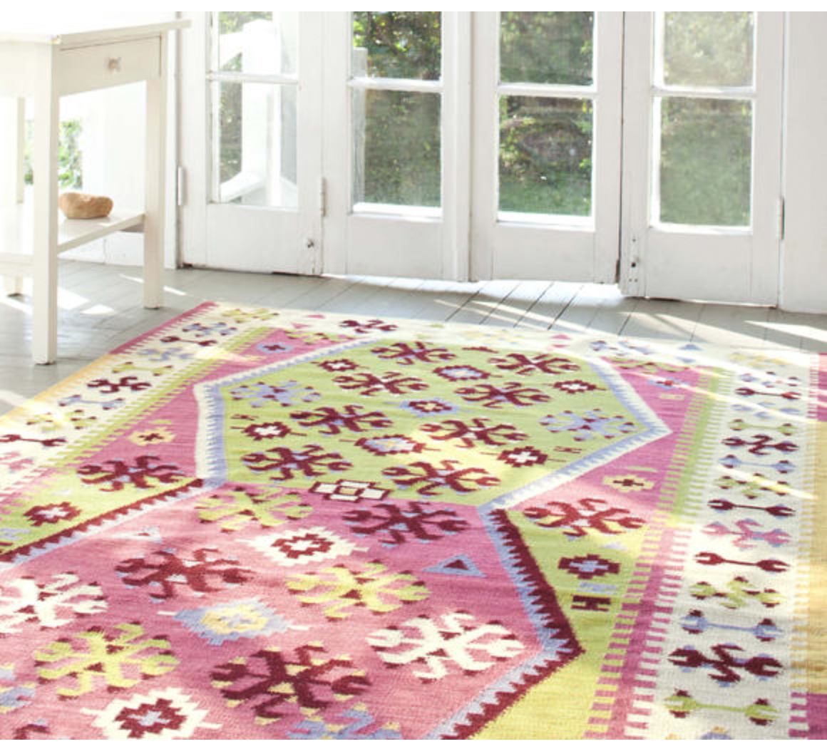 lovely Dash And Albert Rugs in colorful design on wooden floor plus white table for living room decor ideas