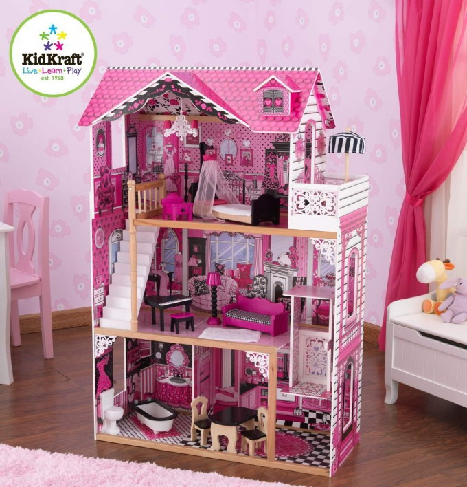 Lovely Kidkraft Majestic Mansion Dollhouse 65252 Made Of Wood In Pink Theme On Wooden Floor Which Matched With Pink Flower Wallpaper For Kids Play Room Decor Ideas