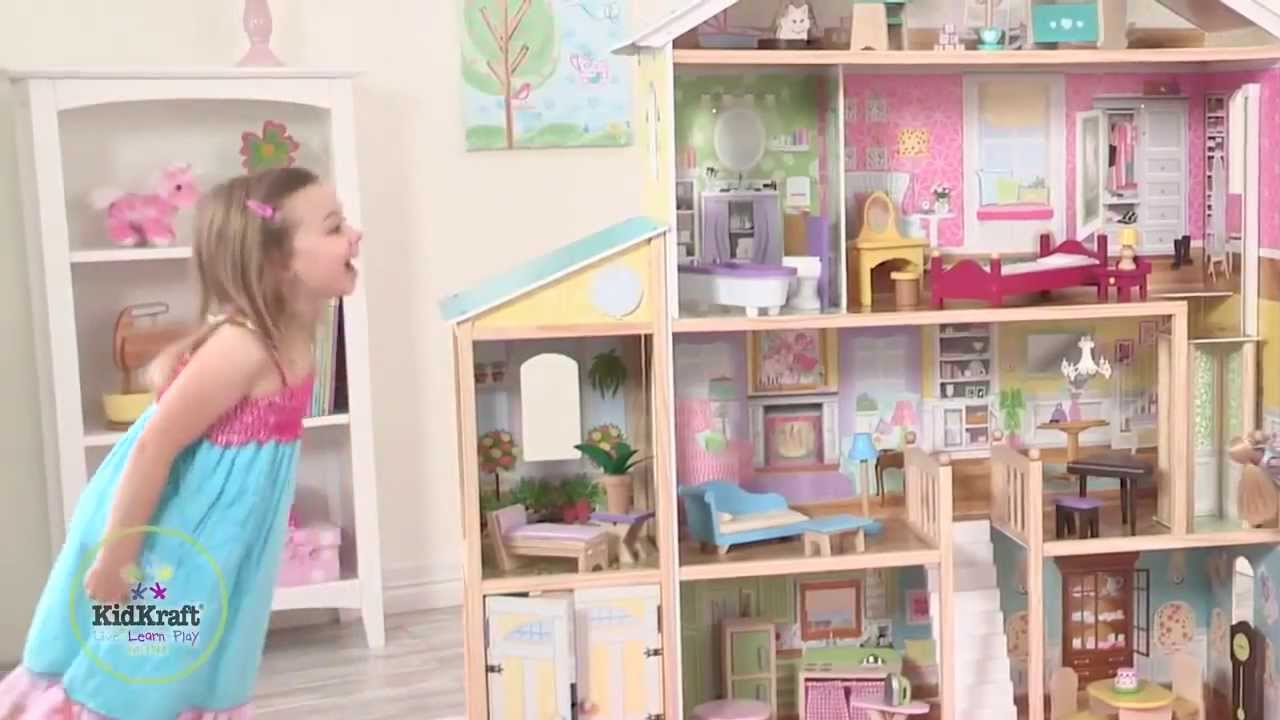 lovely kidkraft majestic mansion dollhouse 65252 made of wood on wooden floor which matched with beige wall for kids room decor ideas