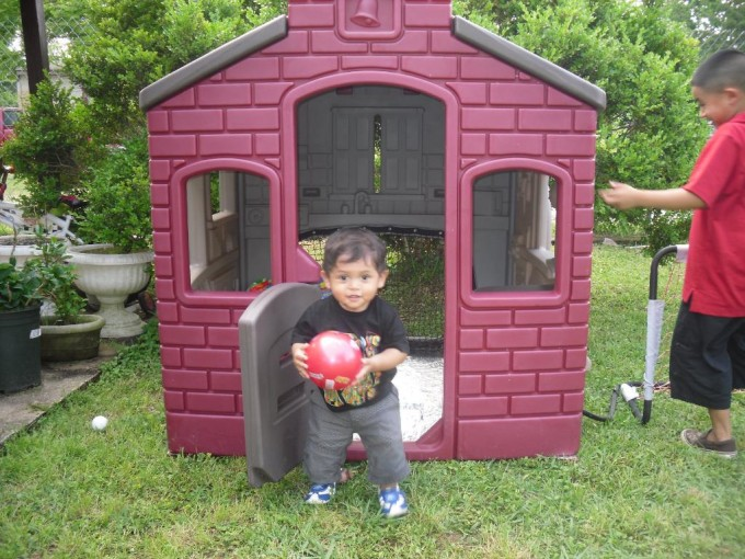 Lovely Little Tikes Playhouse With Maroon Siding And Gray Roof For Playground Decor Ideas