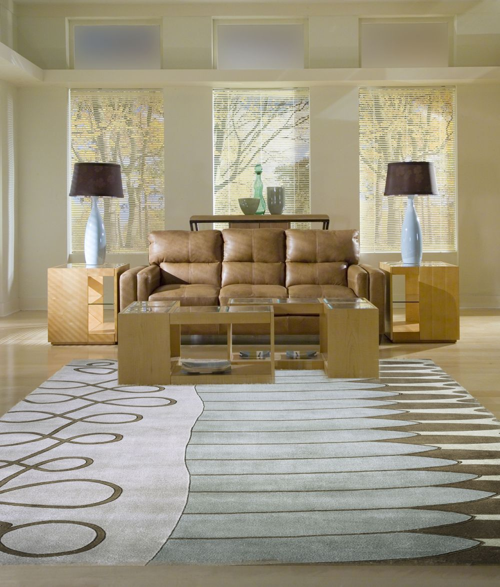 lovely momeni rugs on wooden floor plus brown leather sofa for living room decor ideas