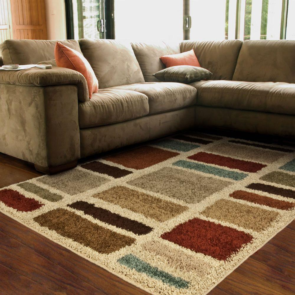 lovely Orian Rugs Moodie Blues Multi 6 ft 7 in x 9 ft 8 in Area Rug on wooden floor plus tan sofa for living room decor ideas