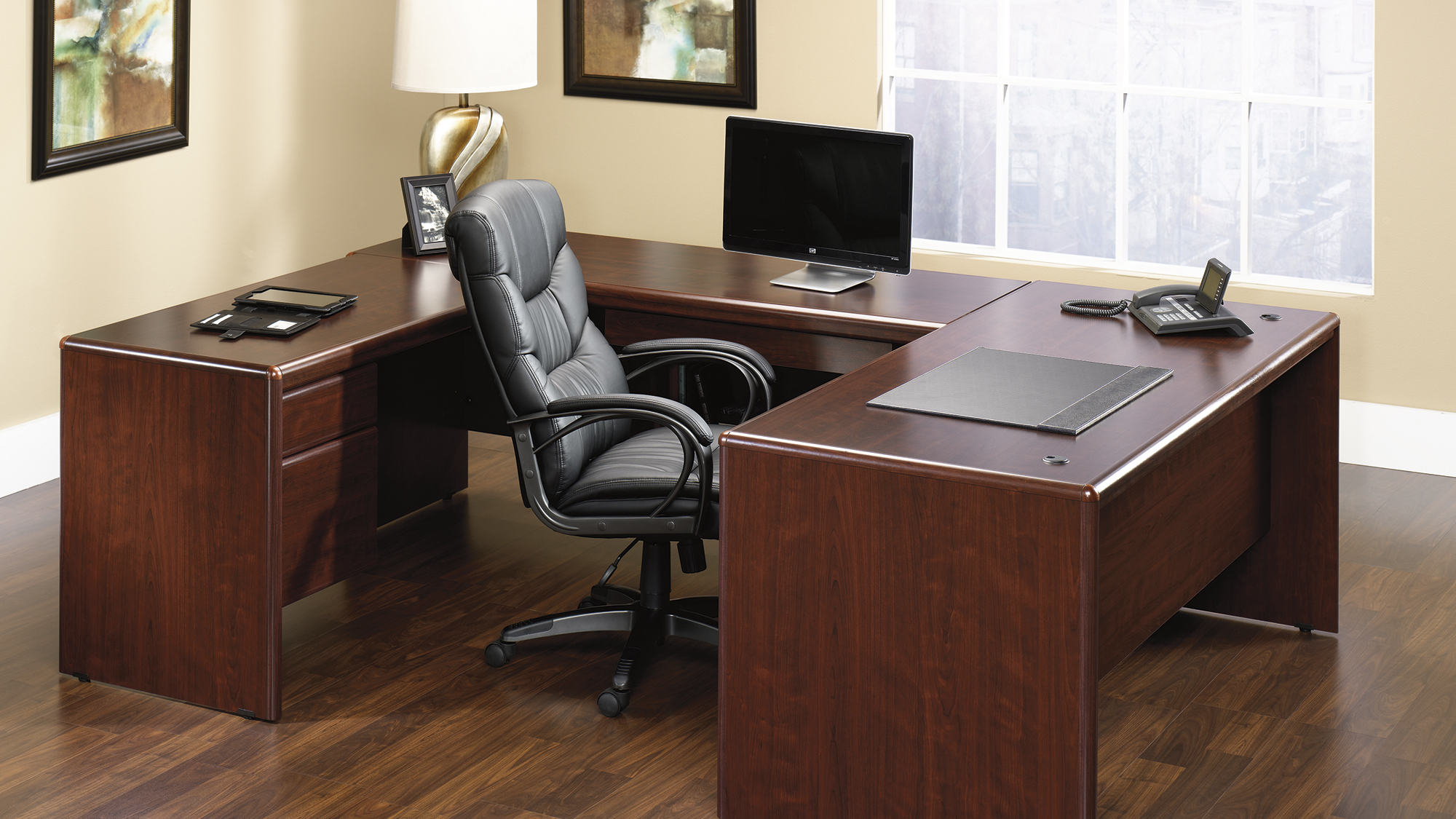 lovely wooden desk by sauder furniture with black chair on wooden floor which matched with cream wall for home office decor ideas
