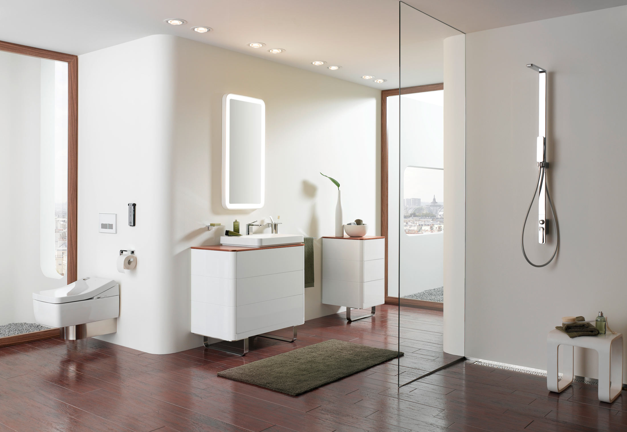 pretty bathroom decor ideas with white wall matched with wooden floor plus bathroom cabinet and toto washlet