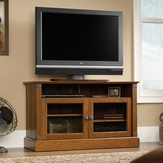 Pretty Carson Forge Panel TV Stand 412921by Sauder Furniture Before Beige Wall Which Matched With Wooden Floor With Floral Rug For Living Room Decor Ideas