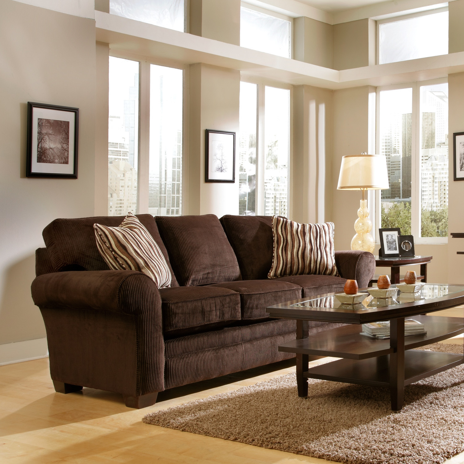 Pretty Dark Brown Sofa By Broyhill Furniture On Wooden Floor With Tan Rug For Living Room Decor Ideas