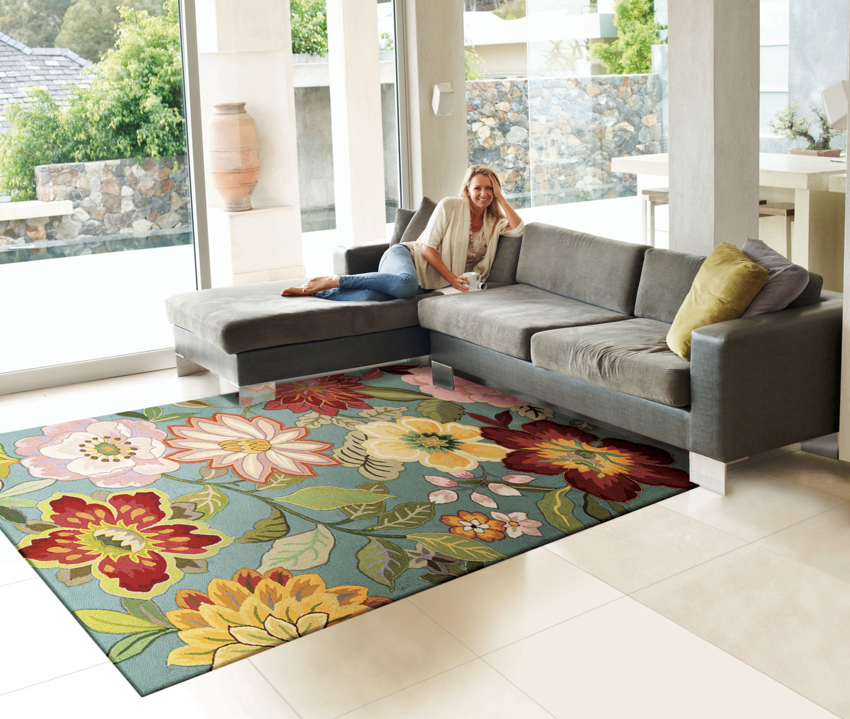 pretty flower pattern of rug by nourison rugs on white tile floor plus gray sofa for living room decor ideas