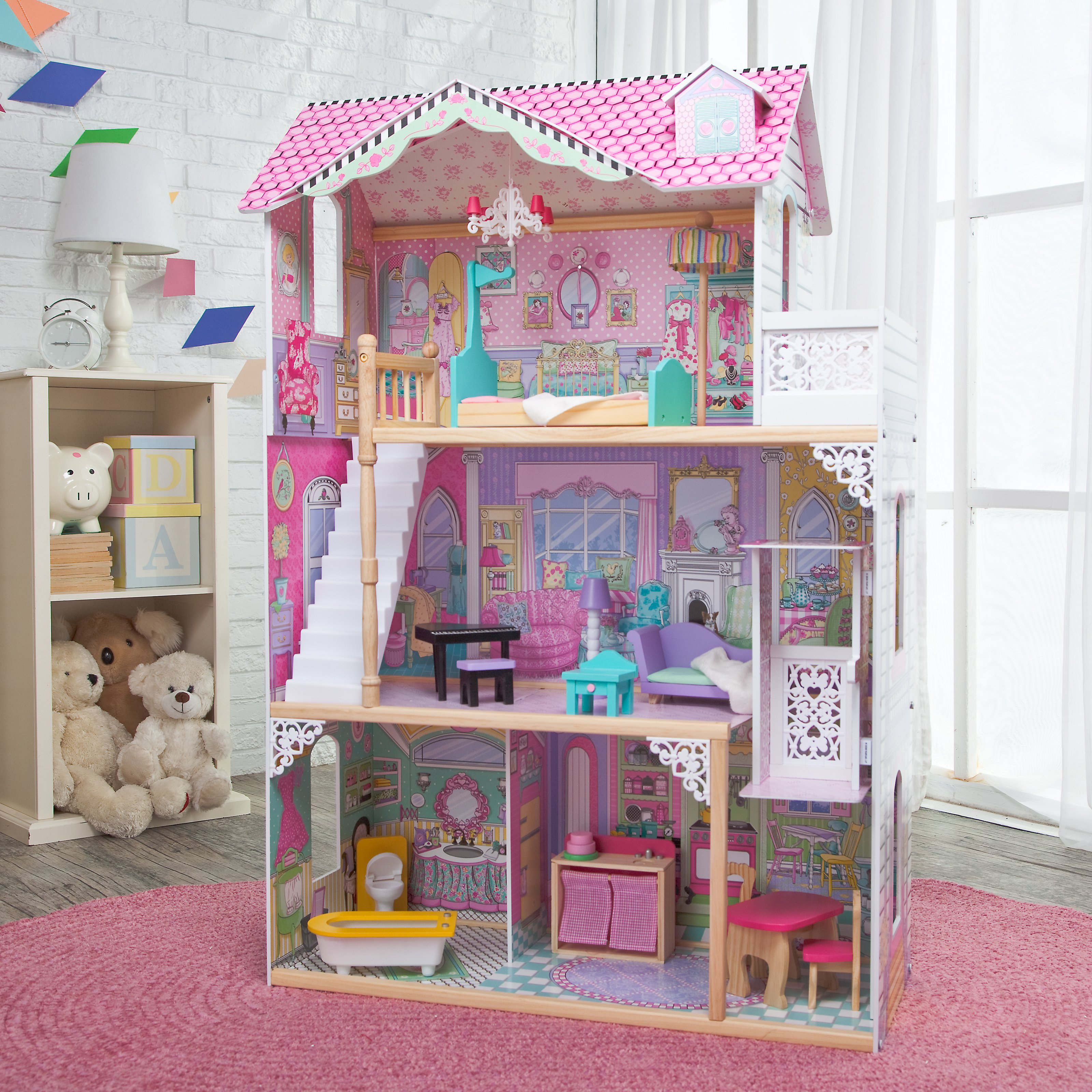 pretty kidkraft dollhouse made of wood in triple tier design with pink roof on pink rug for nursery decor ideas