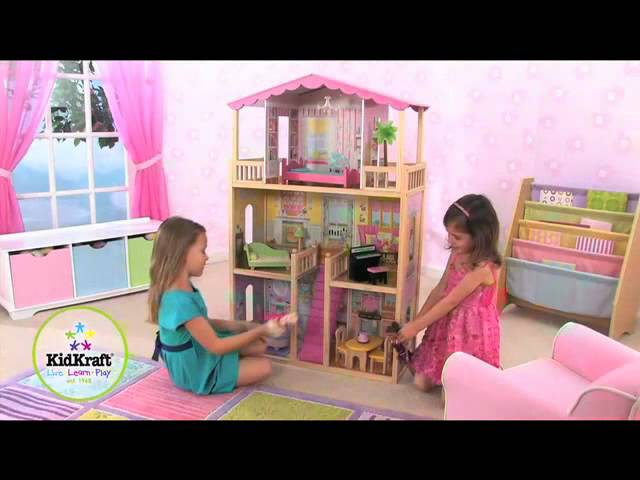 Pretty Kidkraft Majestic Mansion Dollhouse 65252 Made Of Wood On Wooden Floor Matched With Pink Wallpaper For Kids Play Room Decor Ideas