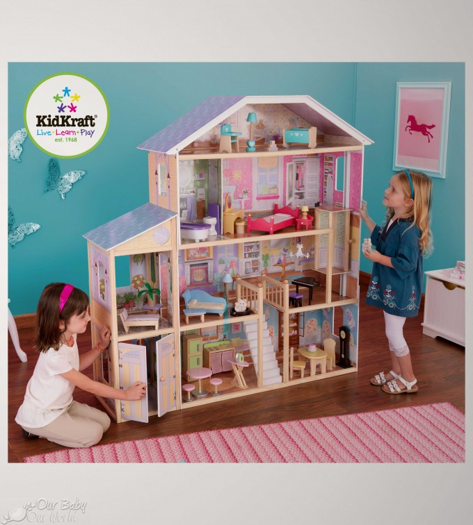 Pretty Kidkraft Majestic Mansion Dollhouse 65252 Made Of Wood On Wooden Floor With Pink Stripped Rug For Nursery Room Decor Ideas