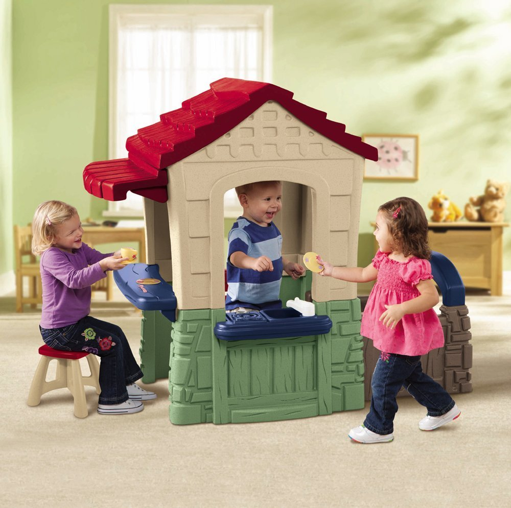 pretty little tikes playhouse with red roof on beige rug which matched with green wall for nursery decor ideas