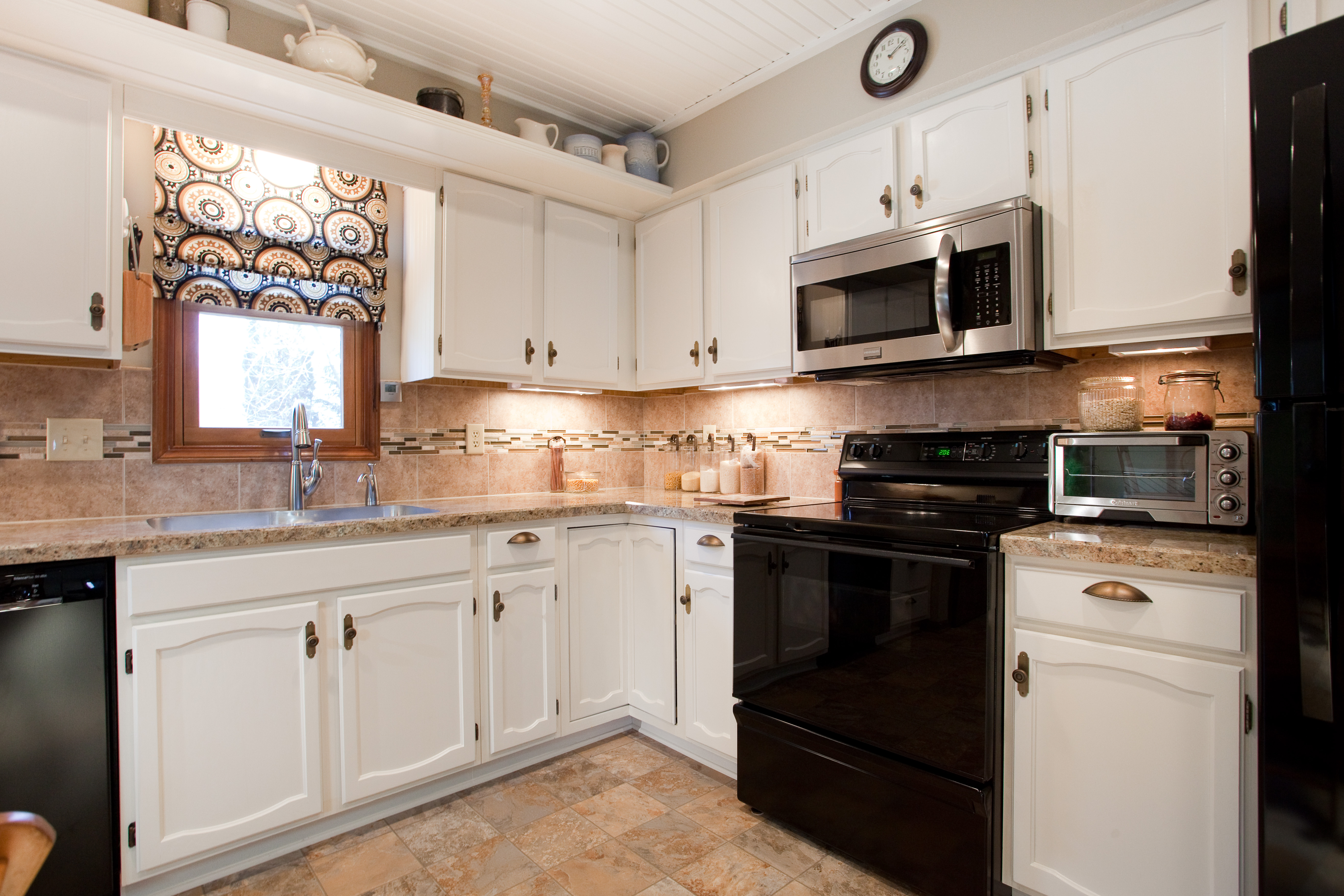 pretty white wooden kitchen cabinet with wilsonart laminate countertops and black stove for kitchen decor ideas