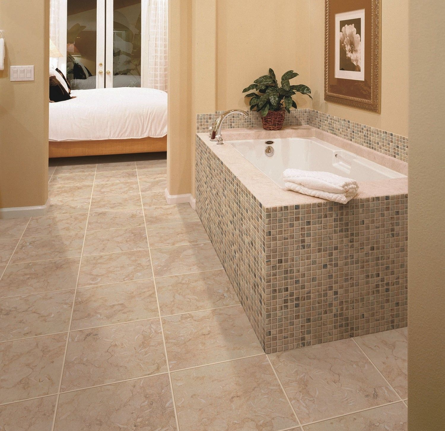 Sea Stone Sand Floor interceramic tile matched with cream wall plus bathup for bathroom decor ideas