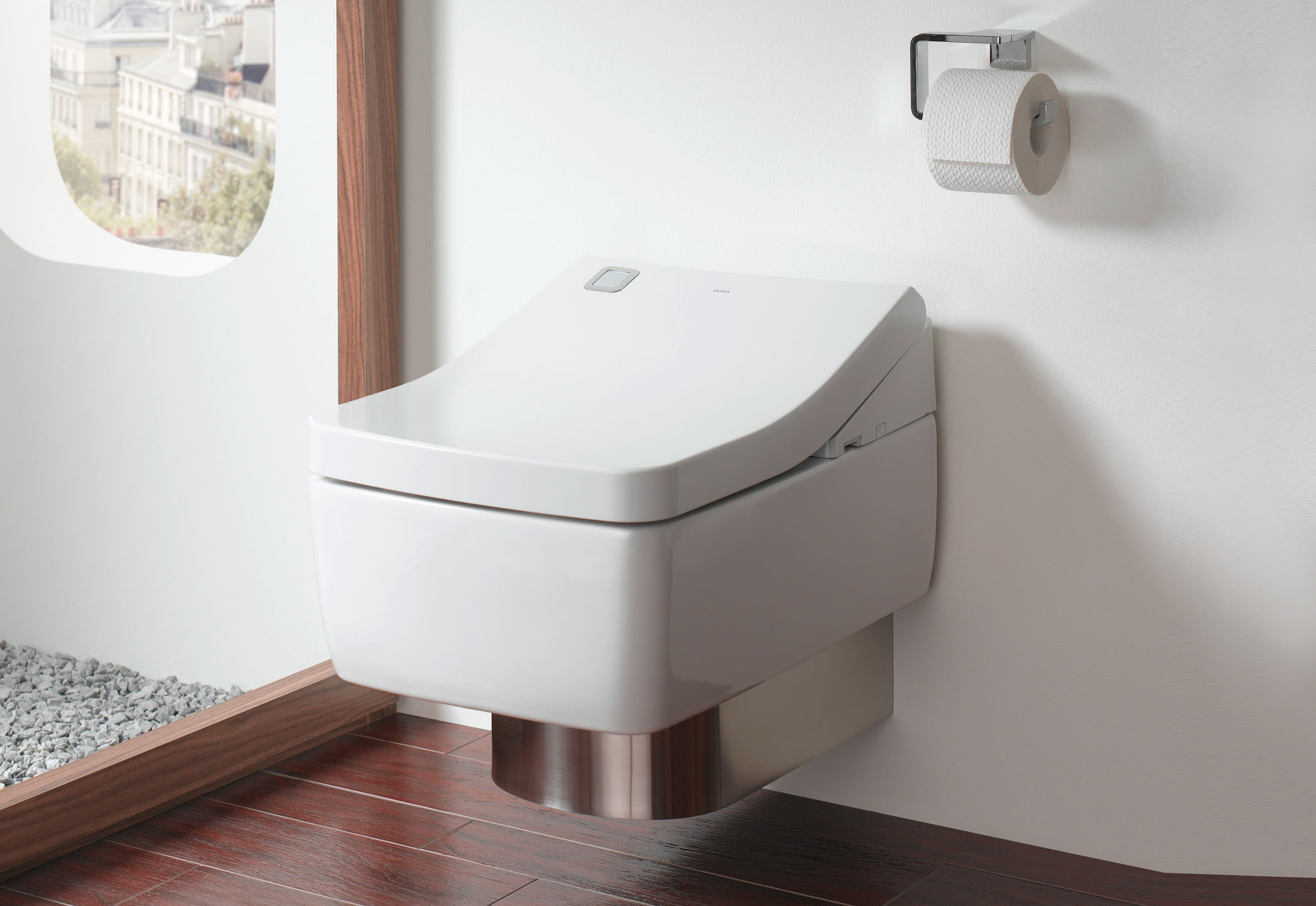 SG Series WC Toto Washlet On White Wall Which Matched With Wooden Floor For Bathroom Decor Ideas