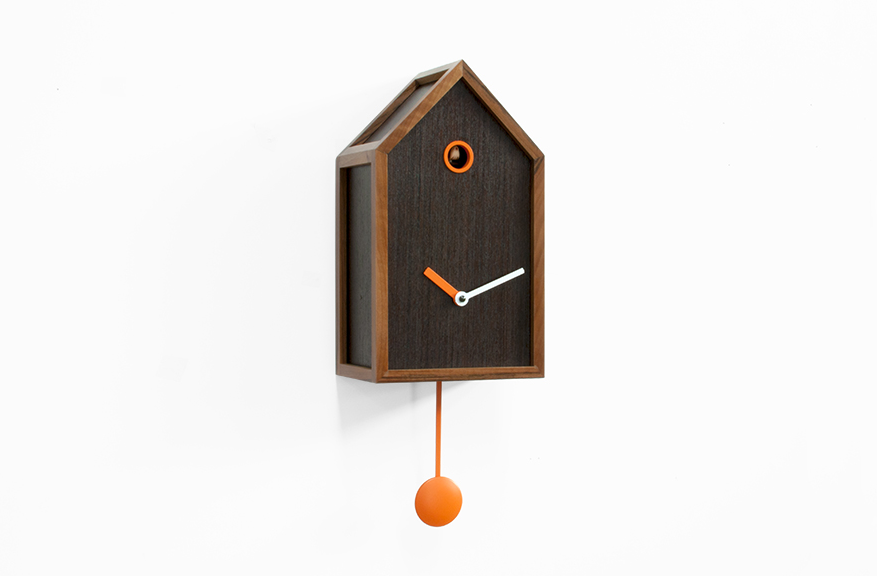 simple cuckoo clock made of wood with white and orange hands for home accessories ideas