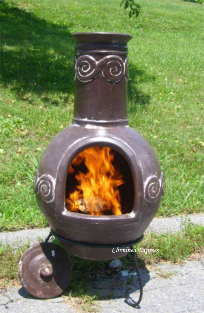 Small Chiminea In Brown Clay With Black Iron Stand For Patio Furniture Ideas