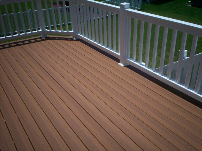 Standard Trex Decking Cost With High Quality Of Brown Wood Material Which Matched With White Wooden Railing For Patio Decor Ideas