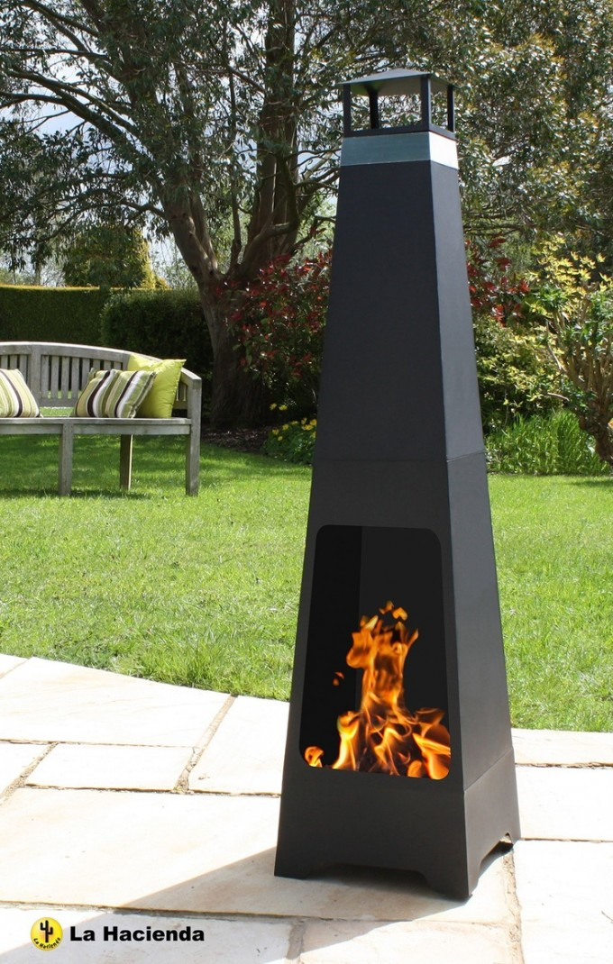Unique Black Chiminea Fireplace On Stone Paver With Green Grass And Wooden Bench For Garden Decor Ideas