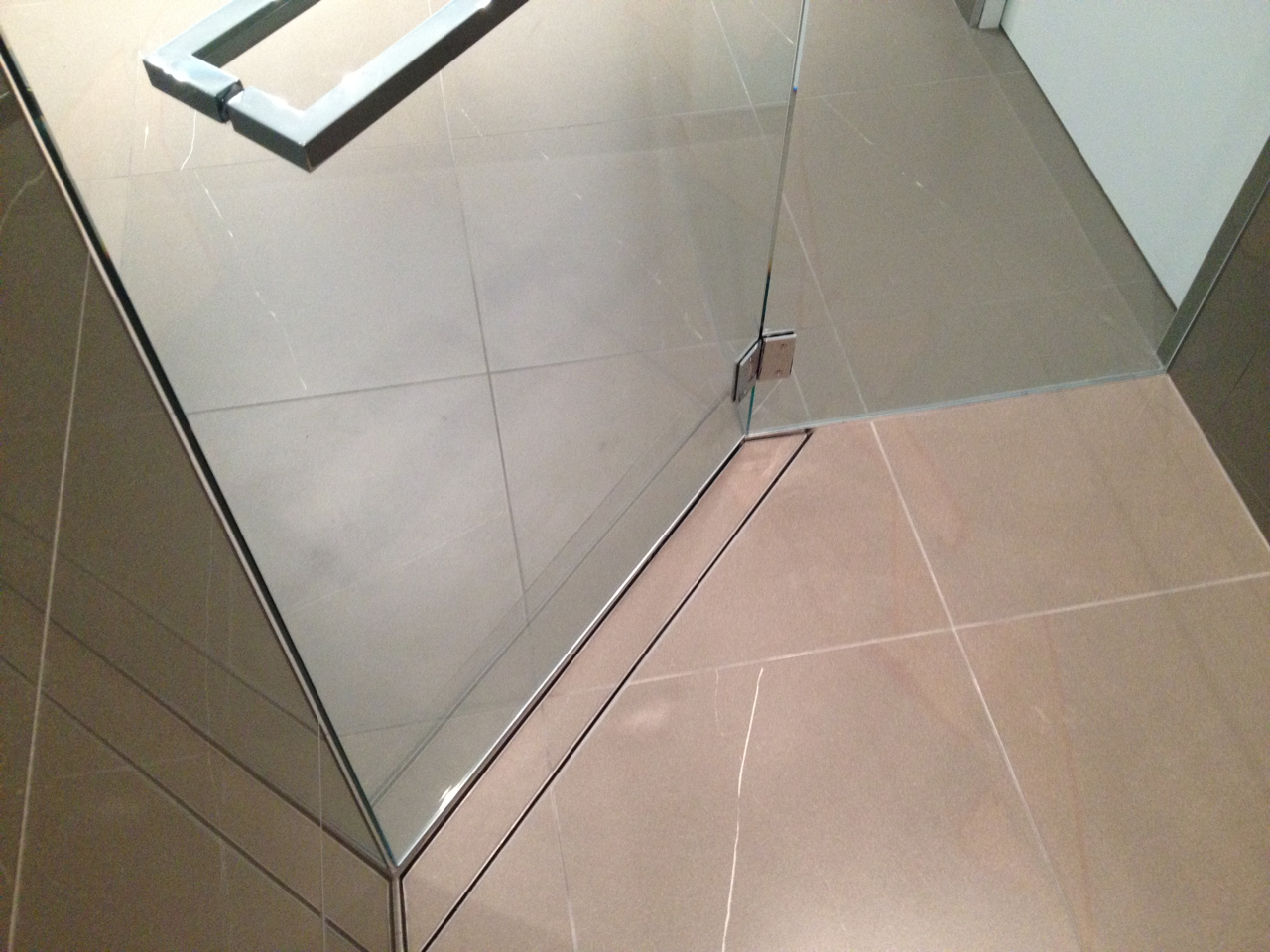 wonderful glass door with schluter strip matched with beige tile flooring for interior design ideas