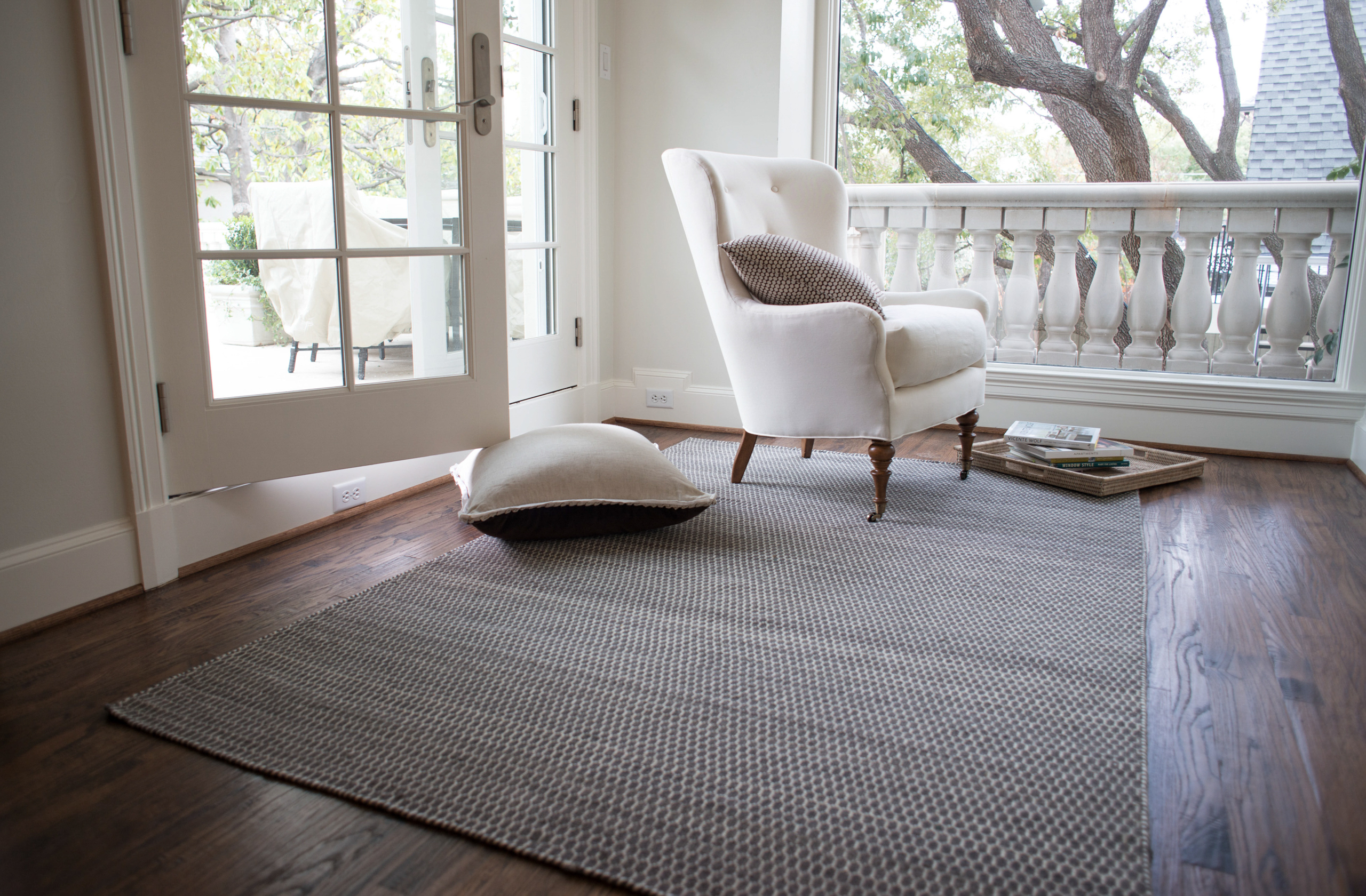 wonderful gray loloi rugs on wooden floor plus single white sofa for living room decor ideas