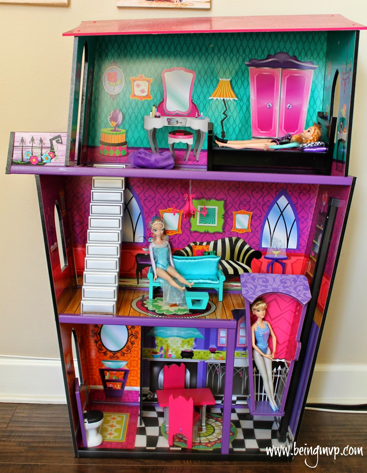 wonderful kidkraft dollhouse in colorful design with triple tier design and barbie inside for nursery decor ideas