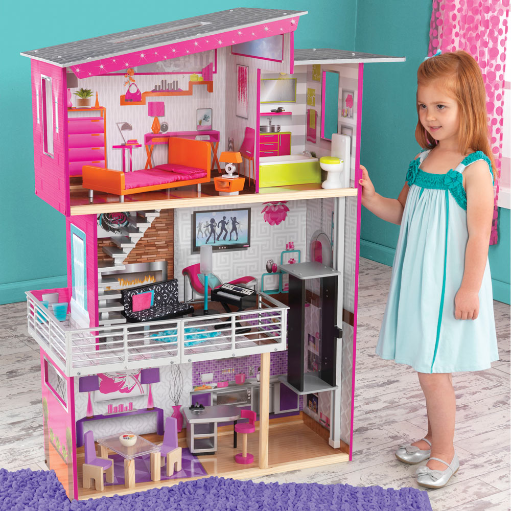 wonderful kidkraft dollhouse in pink and white theme made of wood on wooden floor which matched with blue wall for nursery decor ideas
