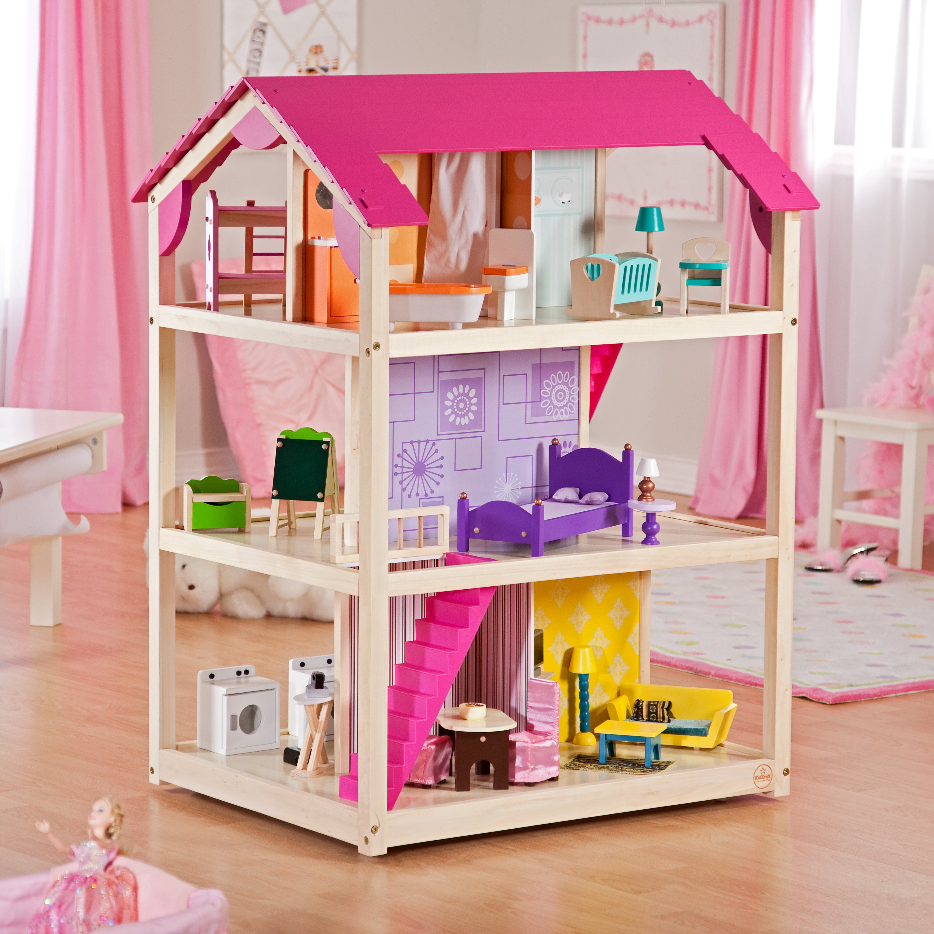 Wonderful Kidkraft Dollhouse Made Of Wood In Cream And Pink Theme On Wooden Floor Which Matched With Beige Wall With Pink Curtain For Nursery Decor Ideas