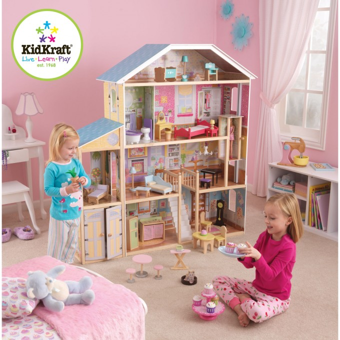 Wonderful Kidkraft Majestic Mansion Dollhouse 65252 Made Of Wood On Beige Rug Matched With Pink Wall For Kids Room Decor Ideas
