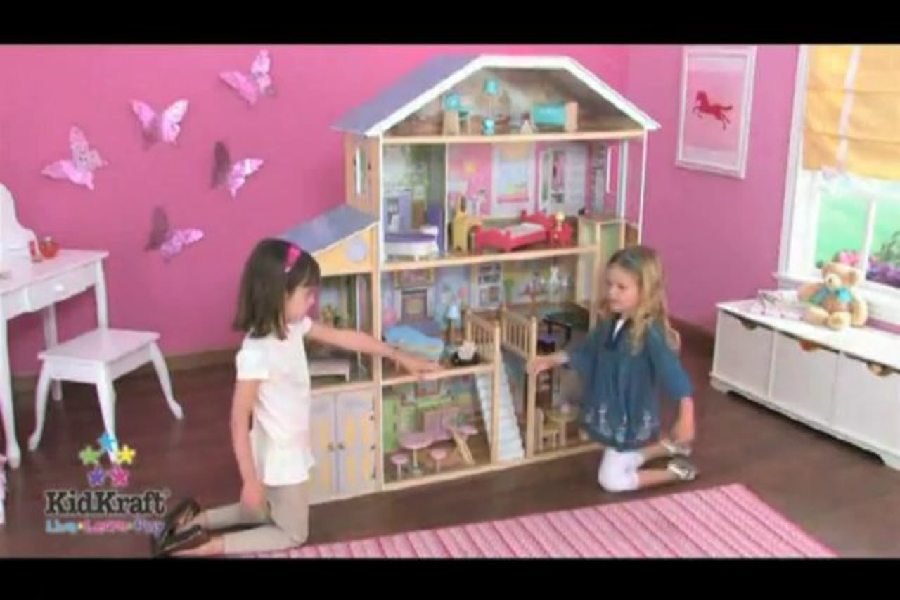 Wonderful kidkraft majestic mansion dollhouse 65252 made of wood on brown wooden floor which matched with pink wall with butterfly ornament for kids room decor ideas
