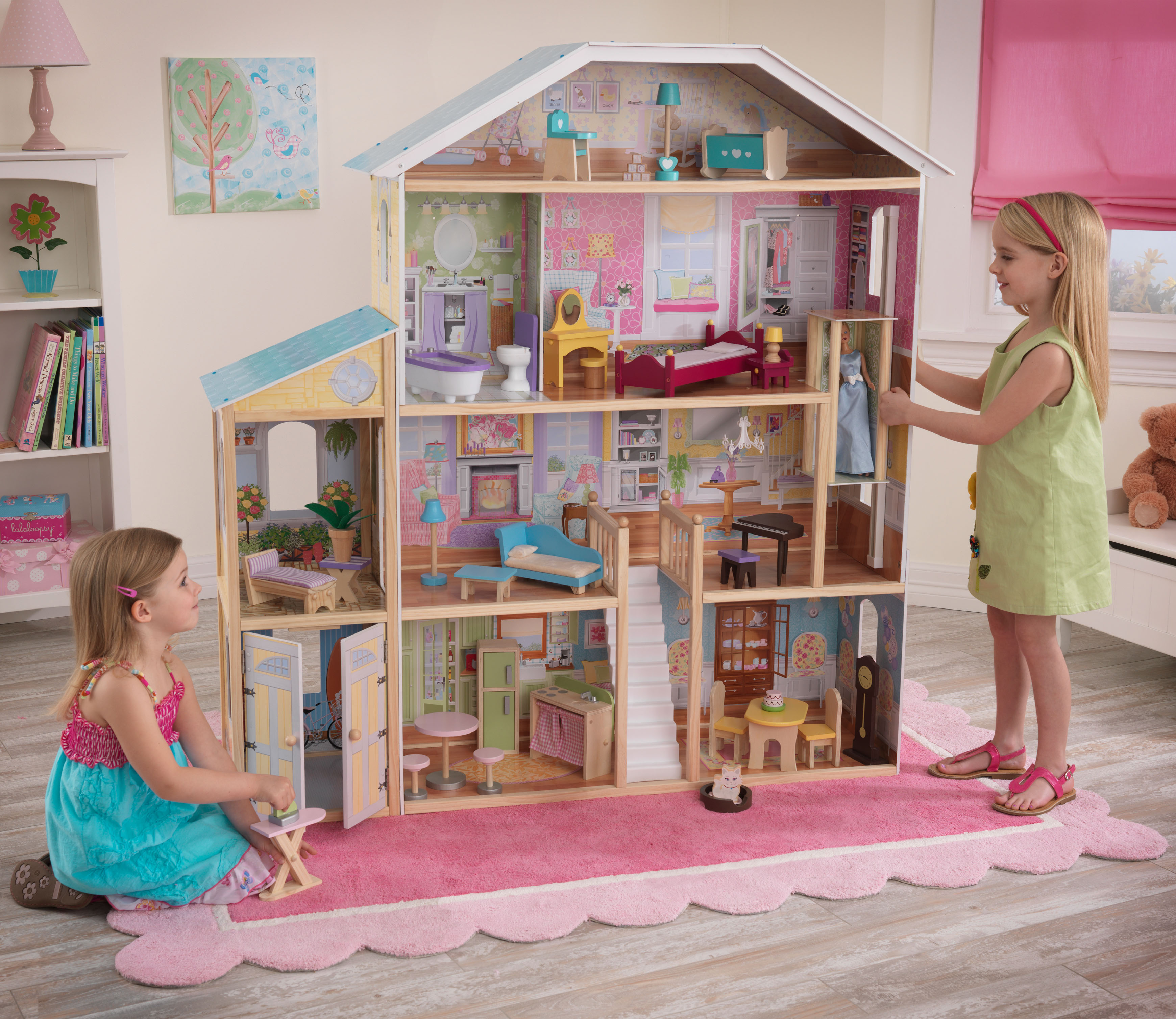 wonderful kidkraft majestic mansion dollhouse 65252 made of wood on wooden floor with pink rug for nursery decor ideas